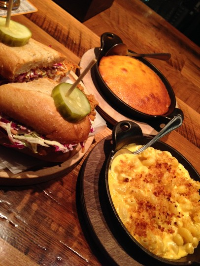 Food [clockwise from left]: Fried Chicken Sandwich (topped with coleslaw and pickles); spoonbread; and macaroni and cheese