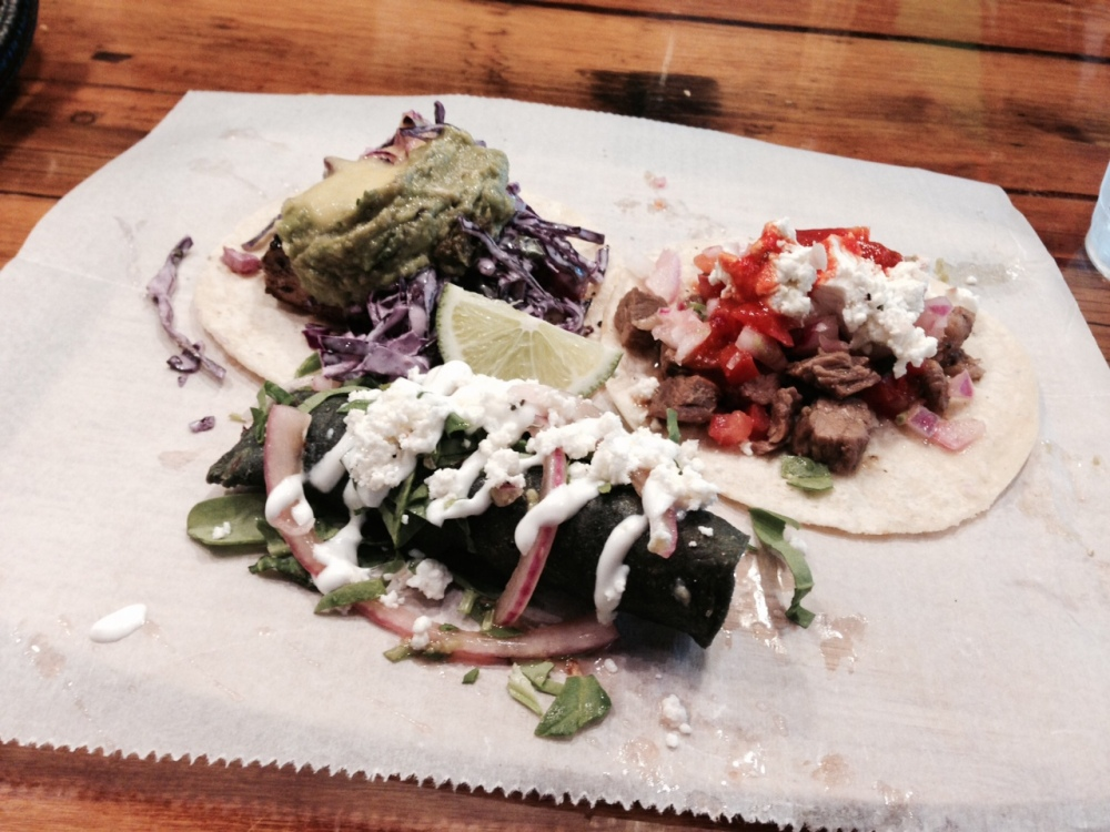 From left: grilled fish taco, taco dorado, and steak taco