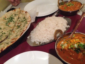 Clockwise from left: Garlic Naan, Chicken Tikka Masala, and Paneer Makhani.