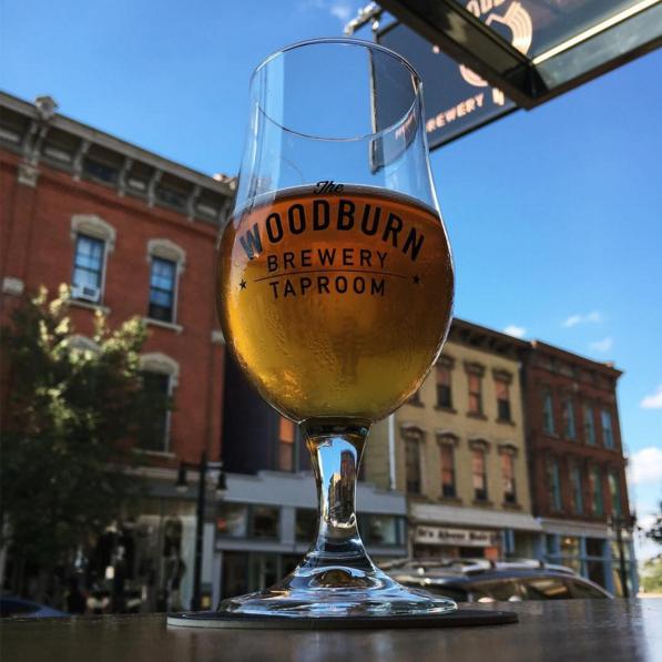 Drinking a beer at a window facing Woodburn Avenue